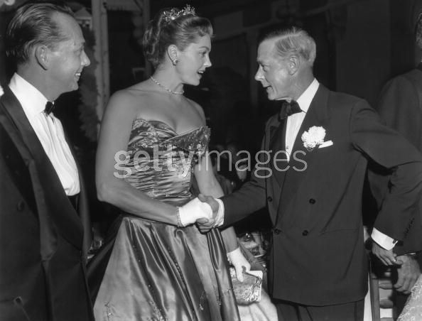 17th March 1956: EXCLUSIVE American actor and swimmer Esther Williams shakes hands with the Duke of Windsor (1894 - 1972) at the Polo Ball, La Coquille restaurant, Boca Raton, Florida. Williams is wearing a strapless evening dress, white gloves, and a tiara. The Duke is dressed in a tuxedo. (Photo by Bert Morgan/Getty Images)